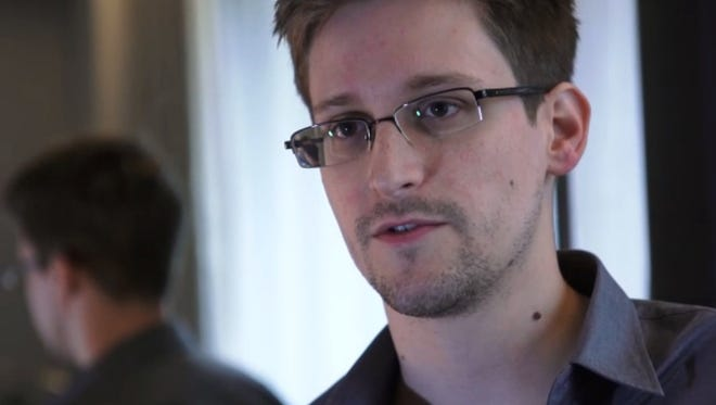 Edward Snowden, who was working at the National Security Agency for the past four years, speaks during an interview with The Guardian newspaper at an undisclosed location in Hong Kong in 2013.