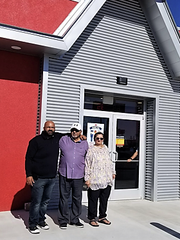 Mo Panjawani and his parents outside his new, franchised Wienerschnitzel location in Fabens.