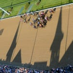 Out of the gate, the racehorses pass between the shadows of the iconic spires of Churchill Downs in the 142nd running of the Kentucky Derby. May 7, 2016.