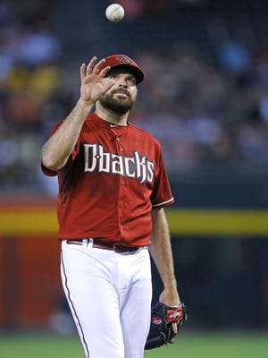 Arizona Diamondbacks starting pitcher Josh Collmenter (55) reacts to a lead off home run by New York Mets' Curtis Granderson (3) during the first inning of their MLB game Sunday, June 7, 2015 in Phoenix, Ariz.