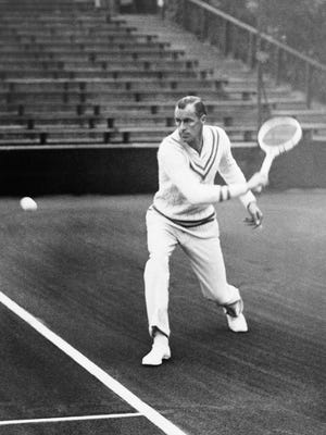 FILE - In this April 1930 file photo, Bill Tilden trains on Rot Weiss grounds at Grunewald near Berlin, Germany. A group is pushing for a historical marker touting the accomplishments of tennis great Bill Tilden at Philadelphia's Germantown Cricket Club, but hit a roadblock over questions about the star's conduct with teenage boys. (AP Photo, File)