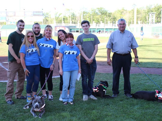 Kasper, his trainers and shelter workers were recognized by the Rockland Boulders for the program.