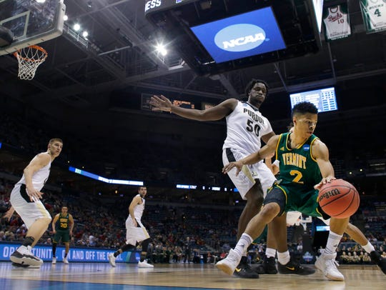 Vermont guard Trae Bell-Haynes (2) is guarded by Purdue