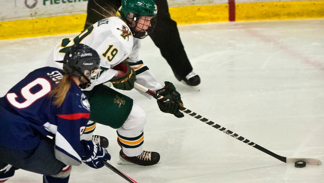 Brittany Zuback (top) and the University of Vermont women's hockey won its season opener Saturday night.