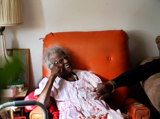 Jeralean Talley sits in the living room of her home