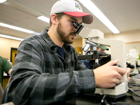 Senior Nick Schultz looks at an algae sample during a phycology lab at the Trainer Natural Resources Building at University of Wisconsin-Stevens Point on Friday, Oct. 2, 2015. Phycology is the study of algae.