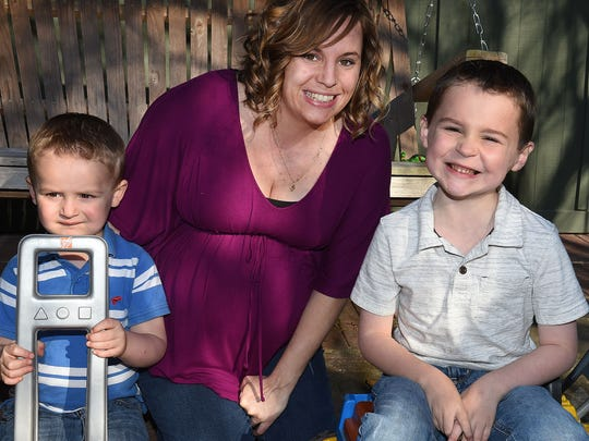 Jayden at home with his mom, Ashley Blumrich and brother