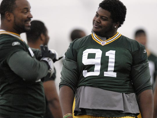 Packers' Cullen Jenkins (77), left, and Justin Harrell (91), right, visit with each other during minicamp inside the Don Hutson Center on Wednesday, June 18, 2008. Photo by Evan Siegle/Press-Gazette