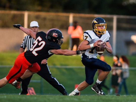 Elco's Braden Bohannon is chased down by Palmyra's Logan Kaylor.