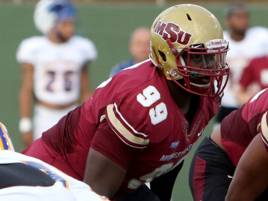 Midwestern State's Michael Nash lines up and waits