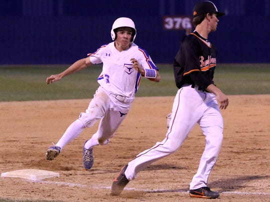 Graham's Owen Loesch rounds third in the game against