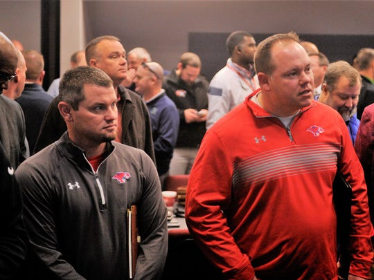 Cooper head football coach and boys athletic coordinator Todd Moebes, right, looks on as the new 2018-20 districts were announced as part of the UIL Realignment on Thursday, Feb. 1, 2018 at the Birdville ISD Fine Arts and Athletics Complex.