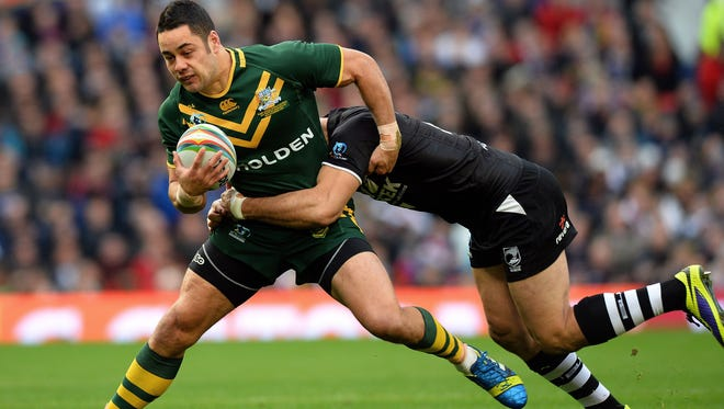 Australia's Jarryd Hayne, left, gets tackled during the 2013 Rugby League World Cup Final between Australia and New Zealand at Old Trafford in Manchester.