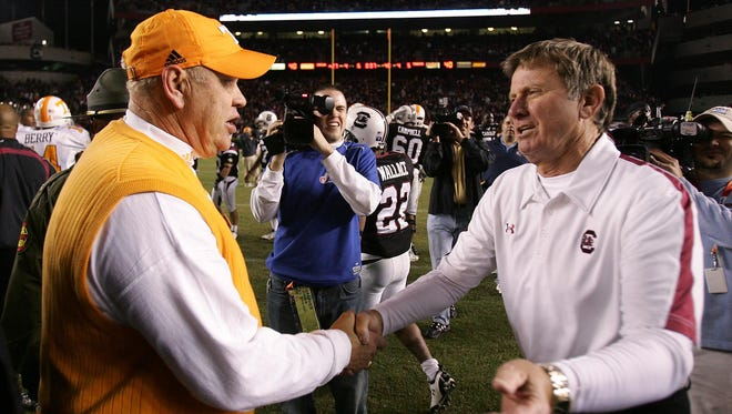 Phillip Fulmer and Steve Spurrier meet at midfield after the Vols lost to South Carolina 27-6 on Nov. 1, 2008. It was the last time the two coached against each other.