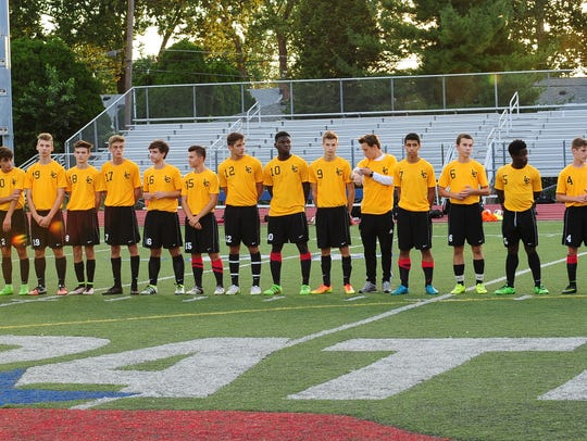 Livonia Churchill players are pictured before the game.
