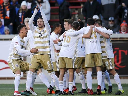 Louisville forward Cameron Lancaster (9) celebrates