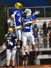 Khadim Fall celebrates a 3rd quarter touchdown with Lang Evans Thursday, June 8th at Kings High School 2017 SWOFCA East/West All-Star Football Game