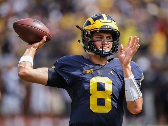 Michigan Wolverines quarterback John O'Korn warms up