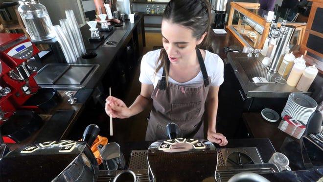 Barista Karen Portillo works the coffee bar at 2ten Coffee Roaster, 145 E. Sunset Road.