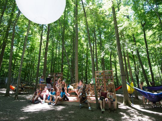 Festival-goers hanging out in The Nook at the Firefly
