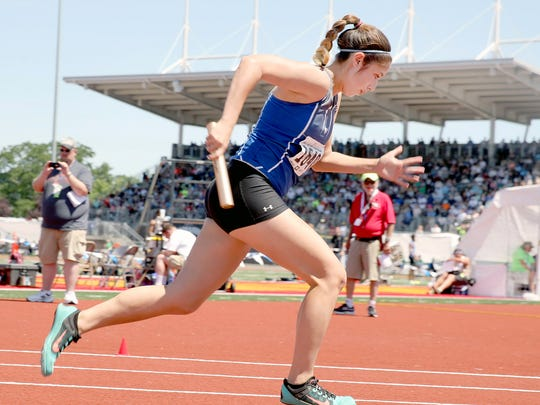 Olympic's Stephanie Barr starts the first leg of the 4x100 meter relay on Saturday at the state track meet in Tacoma.