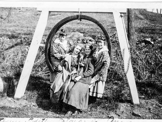 636429037239266540-d.-the-daniels-twins-clara-anderson-and-a-friend-sitting-on-the-fire-bell-across-from-Heatons-barn-family-photo-restored-by-Dr.-Arnold-Roufa.jpg