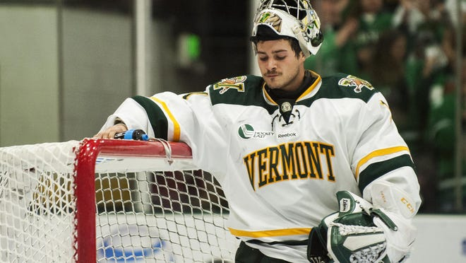 Catamount goalie Mike Santaguida (1) takes a drink of water after allowing a goal during the men's hockey game between North Dakota and Vermont at Gutterson Fieldhouse in October.