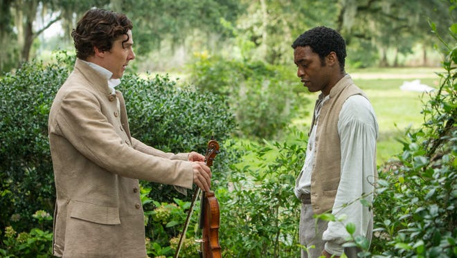 Benedict Cumberbatch, left, and Chiwetel Ejiofor in a scene from '12 Years A Slave.'