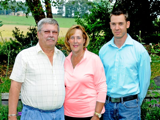 Lindy Sweeney poses with her husband, Steve, and their