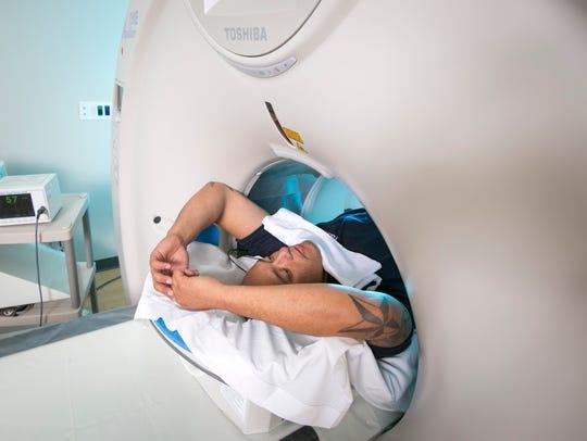 Monterey Firefighter Raul Pantoja receiving a CT scan