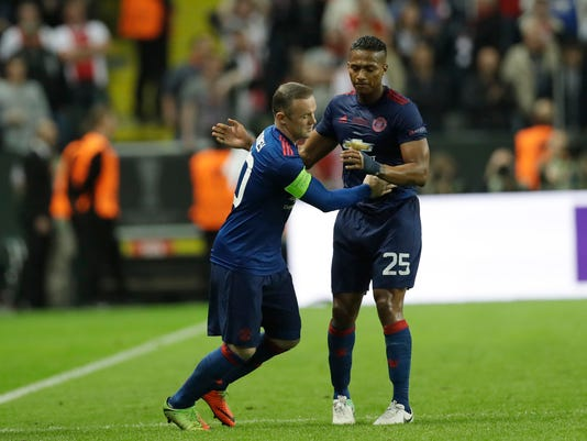 Manchester's Wayne Rooney is welcomed by Antonio Valencia as he enters the pitch during the soccer Europa League final between Ajax Amsterdam and Manchester United at the Friends Arena in Stockholm, Sweden, Wednesday, May 24, 2017. (AP Photo/Michael Sohn)