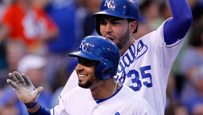 Kansas City Royals' Omar Infante (14) celebrates with Eric Hosmer (35) after hitting a grand slam home run in the third inning of a baseball game against the Los Angeles Angels at Kauffman Stadium in Kansas City, Mo.