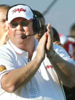 Maryland coach Ralph Friedgen applauds his team during the fourth quarter of Maryland's 41-7 win over West Virginia in the Gator Bowl on Jan. 1, 2004, in Jacksonville, Fla.