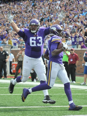 Two plays after taking away an Adrian Peterson touchdown, Vikings quarterback Teddy Bridgewater strolls into the end zone with guard Brandon Fusco for a touchdown in the second quarter.