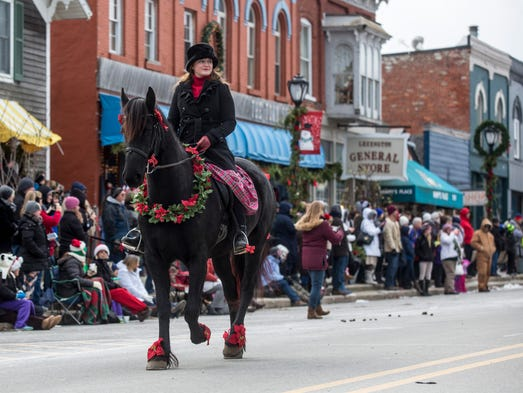 Horses trot down Huron Avenue during the Old Fashioned