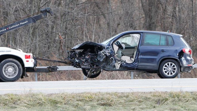 A Volkswagen SUV, which was driven by Tatiana Tchekina, sits hooked to a tow truck as Monroe County Sheriff technicians work the scene of a fatal accident in the eastbound lane of I-490 at Route 204 (Exit 6) in Gates on Saturday afternoon.