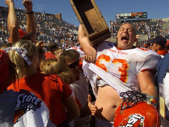 Iowa State offensive lineman Ben Bruns raises the Cy-Hawk Trophy in celebration of the Cyclones' 24-14 win against Iowa on Sept. 16, 2000, at Kinnick Stadium in Iowa City.