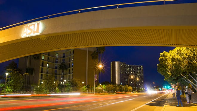 Traffic flows on University Drive in front of Palo Verde East, left, and Manzanita Hall at Arizona State University.