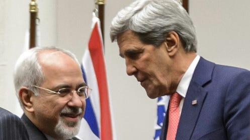 Iranian Foreign Minister Mohammad Javad Zarif shakes hands with U.S. Secretary of State John Kerry after a statement on Nov. 24.