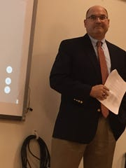 Dan Cicala, president of Fidevia Construction Management & Consulting and the project manager for the construction of a new Northwest Elementary School, delivers bid results to the Lebanon School Board Monday night.