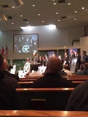 U.S. marshals look on as Rev. John O. Parker Jr. speaks