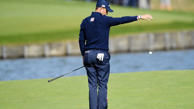 Justin Thomas takes a drop at the 2018 Ryder Cup. (Stuart Franklin/Getty Images)
