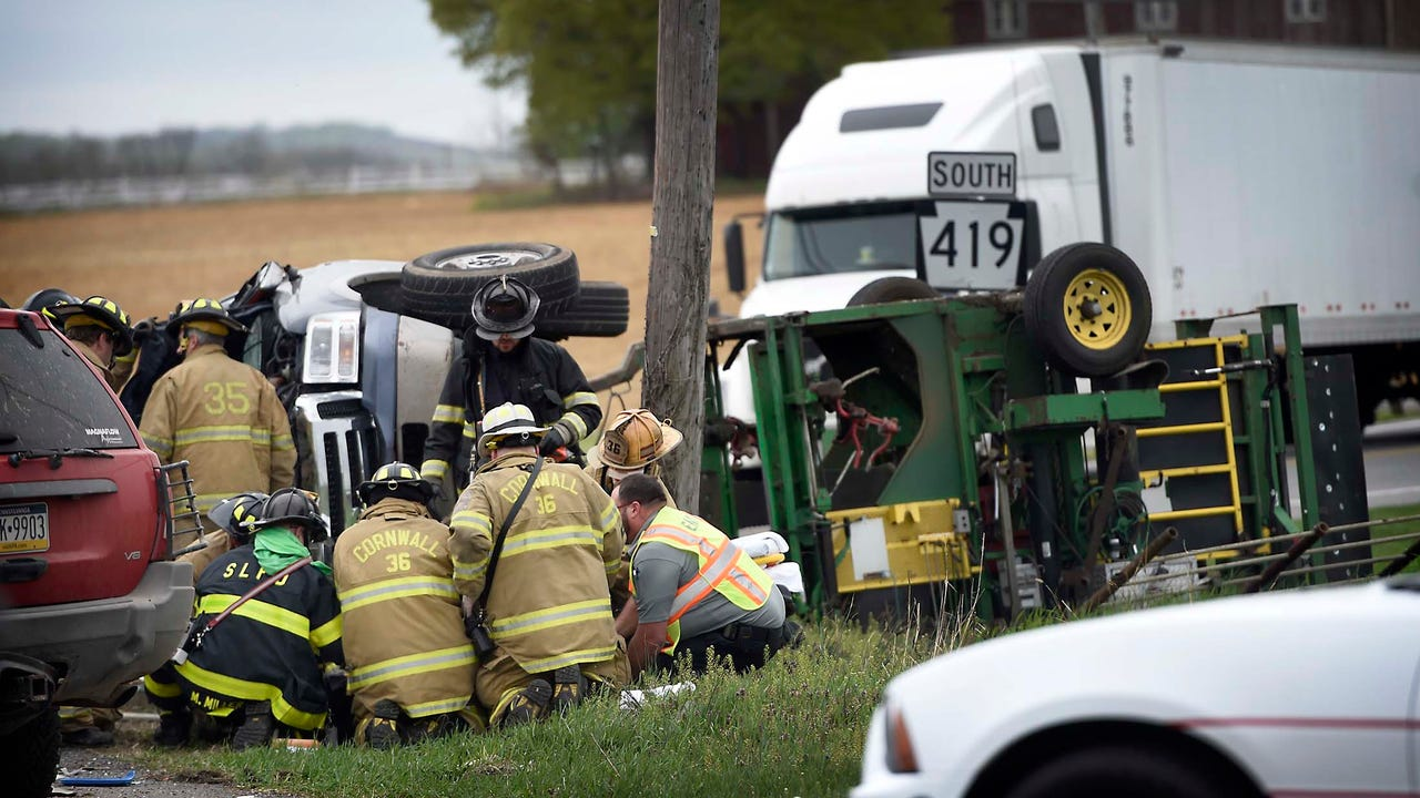 One man was left pinned under a vehicle following a three car collision Wednesday, April 18.