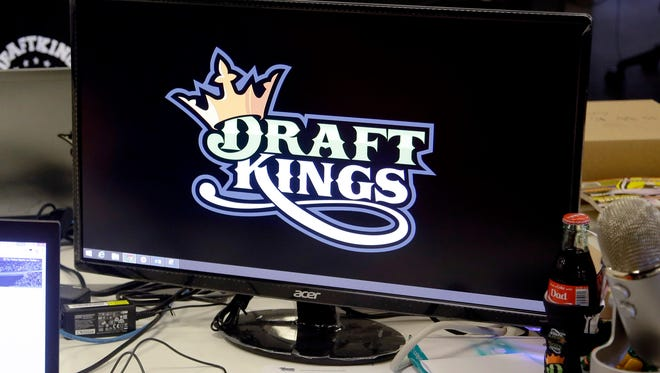 In this file photo, Len Don Diego, marketing manager for content at DraftKings, a daily fantasy sports company, works at his station at the company's offices in Boston. Nevada Gaming Control has ordered DraftKings, FanDuel and all other daily fantasy sites must cease and desist operating in the state.