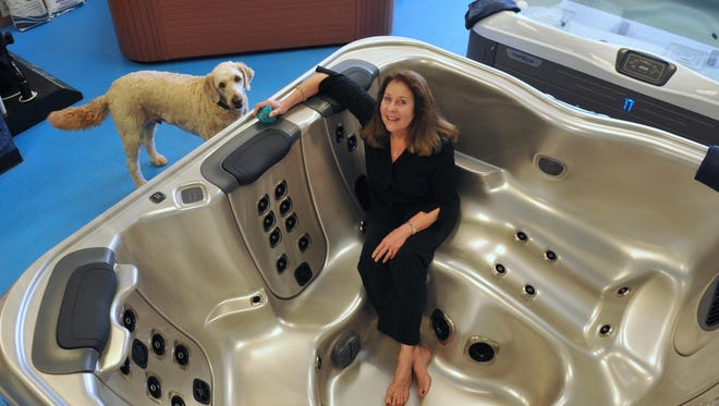 Debbie Pierce is co-owner of C&W Pump, Pool & Motors, located in Indian Harbour Beach. At left is one of the store mascots, Kona.