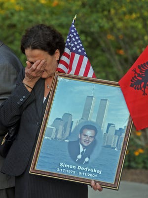 Victoria Dedvukaj of Mohegan Lake cries as she holds a photograph of her son Simon before the Westchester County 9/11 Memorial Ceremony at The Rising, the county's Sept. 11th memorial at Kensico Dam Plaza in Valhalla Sept. 11, 2015. Dedvukaj was one of 111 county residents and 12 former residents killed in the Sept. 11, 2001 attacks on the World Trade Center.