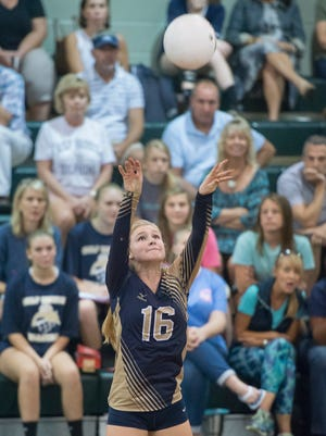 Olivia Hepworth (16) sets the ball during the Gulf Breeze vs Catholic high school volleyball game at Catholic High School in Pensacola on Tuesday, October 10, 2017.