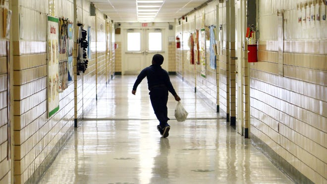 In this Oct. 28, 2015 photograph, a Walton Elementary student skips to class at the Jackson, Miss., school. Walton and Mississippi's 1,000 other public schools have been affected by a variety of changes supported by the current Legislature. And with the general election only days away, a new batch of lawmakers could affect additional changes ranging from funding to expanding eligible areas for charter schools to rewriting the state's funding formula.