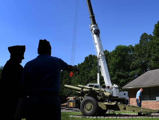 A howitzer used in WWII is moved from the property