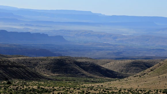 The St. George area can be seen in the background from the Mojave Desert Joshua Tree Road Scenic Backway southwest of Ivins City.
